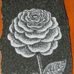 Granite Etching of Rose. This piece uses traditional pointilism to define all the countours & shadows. A typical motif for monuments.