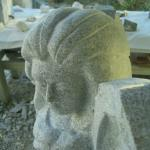 Granite angel. I start with the face. I carve what comes to mind. No models are used for this carving. It must look beautiful or I won't continue.