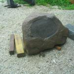 Granite boulder with new smooth surface ready for an inscription.